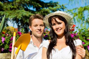 happy couple in the garden in summerの写真素材 [FYI00841161]