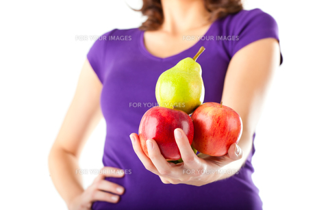 healthy eating - woman with apple and pearの写真素材 [FYI00844237]