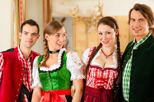 young people in traditional bavarian tracht in a business or restaurantの写真素材 [FYI00847043]