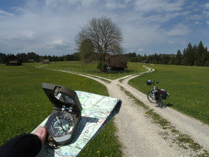 with map and compass: cycling in the ammergau alpsの写真素材 [FYI00847578]