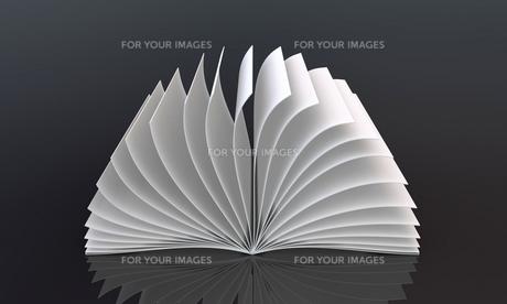white book on blackの写真素材 [FYI00849868]