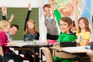child or pupil at a school blackboard at schoolの写真素材 [FYI00853397]