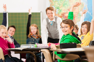 child or pupil at a school blackboard at schoolの写真素材 [FYI00853417]
