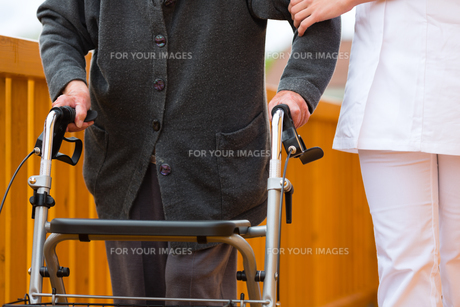 age and care - nurse and a senior citizen with walkerの素材 [FYI00854649]