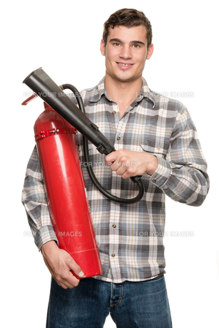 man with fire extinguisherの写真素材 [FYI00856831]