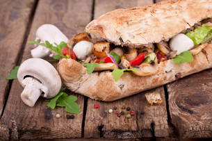 ciabatta baguette with fresh mushroomsの写真素材 [FYI00857169]