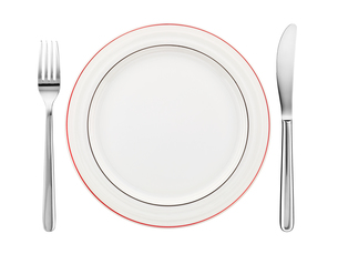 place setting with plate,knife and fork isolated on whiteの写真素材 [FYI00857186]