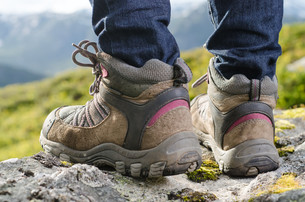 two hiking boots before mountain landscapeの写真素材 [FYI00859418]