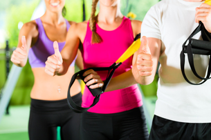 fitness center - happy people in front of the sportの写真素材 [FYI00859585]