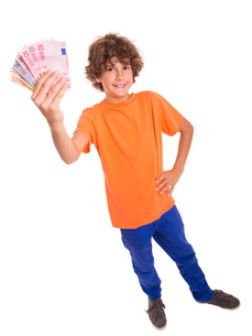 child with banknotes in his handsの写真素材 [FYI00864673]