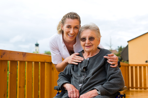 age and care - nurse and a senior in wheelchairの素材 [FYI00866030]