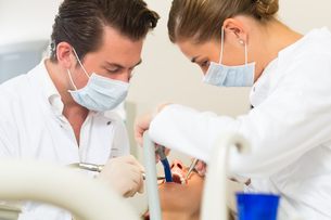 patient at the dentist - treatment with drillingの写真素材 [FYI00867092]