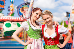 young women in traditional bavarian dirndl dress or on a spring festival or oktoberfestの写真素材 [FYI00867922]