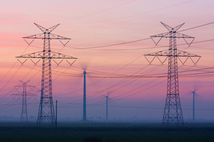 electricity pylons and wind turbines at duskの写真素材 [FYI00868224]
