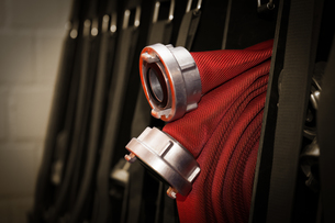 firefighters c hose rolled up in the fire station - sepiaの写真素材 [FYI00869084]