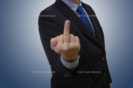 businessman showing middle fingerの写真素材 [FYI00869955]