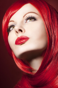 beautiful young woman with shiny,red hair and perfect makeupの写真素材 [FYI00870229]