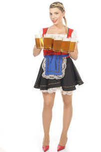 blonde young woman in dirndl with many beer mugsの写真素材 [FYI00877441]