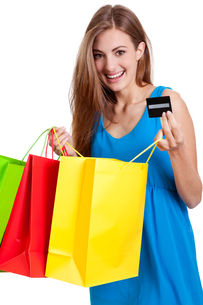 young happy woman with colorful shopping bags shopping isolatedの写真素材 [FYI00878628]