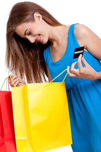 young happy woman with colorful shopping bags shopping isolatedの写真素材 [FYI00878704]