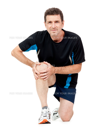 adult one in sportswear and knee painの写真素材 [FYI00878807]