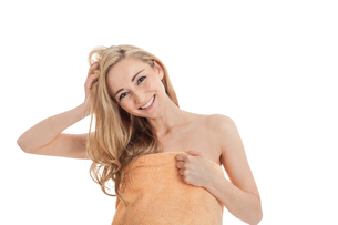 attractive young woman laughing with a towel isolatedの写真素材 [FYI00879777]