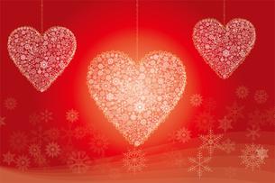 クリスマスのイメージの背景イラスト|雪の結晶で描いた3連のハート|Merry Christmasのイラスト素材 [FYI00889979]
