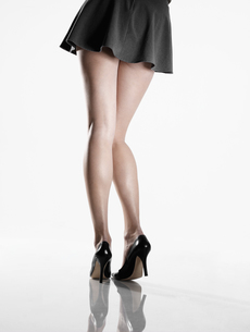 Woman wearing mini skirt and high heelsの素材 [FYI00901820]