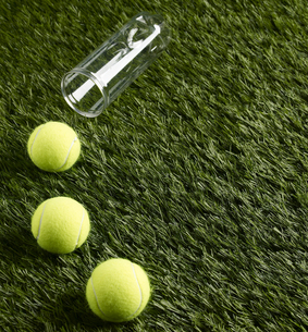 Three Tennis Balls on Grassの素材 [FYI00905305]