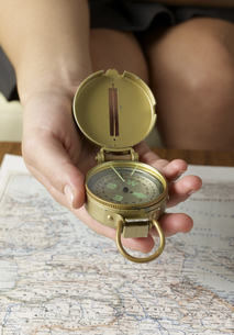 Close-Up of Using Compass above Mapの素材 [FYI00907243]
