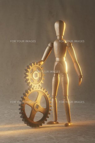 重なる歯車と人形の素材 [FYI00961615]