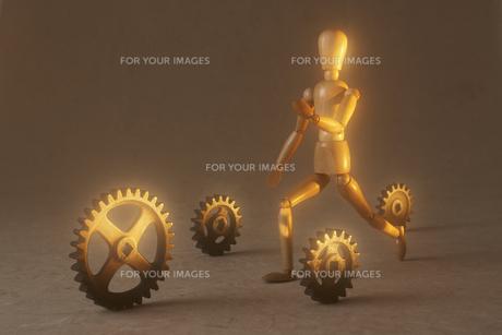 走る人形と歯車の素材 [FYI00961642]
