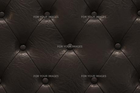 高級感溢れる黒のヴィンテージ感のあるパッド型の革張りの質感の写真素材 [FYI01226590]