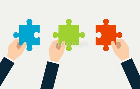 パズルと手 ビジネスイメージのイラスト素材 [FYI01255907]