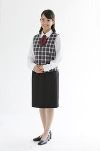 制服姿の笑顔の女性の写真素材 [FYI01284727]