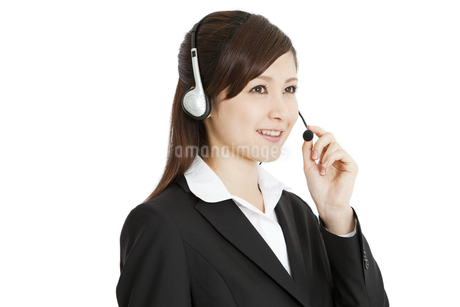 インカムをするビジネスウーマンの写真素材 [FYI01291773]