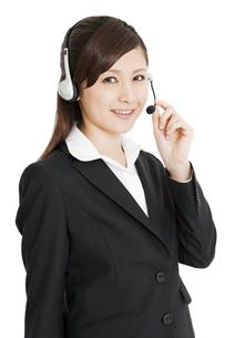 インカムをするビジネスウーマンの写真素材 [FYI01292119]
