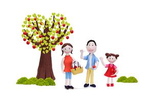 ハートの木のリンゴを収穫する親子の写真素材 [FYI01348687]