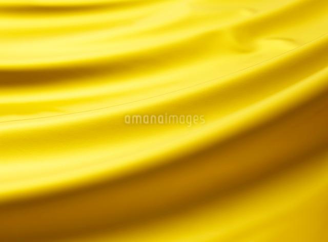 金の布のドレープの背景素材の写真素材 [FYI01351208]