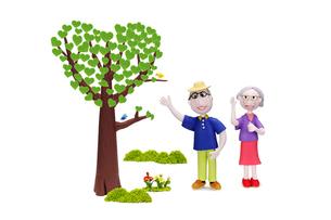 老夫婦とハートの木と2羽の小鳥の写真素材 [FYI01355710]
