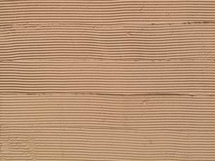 コテ跡の残る壁面の写真素材 [FYI01357494]