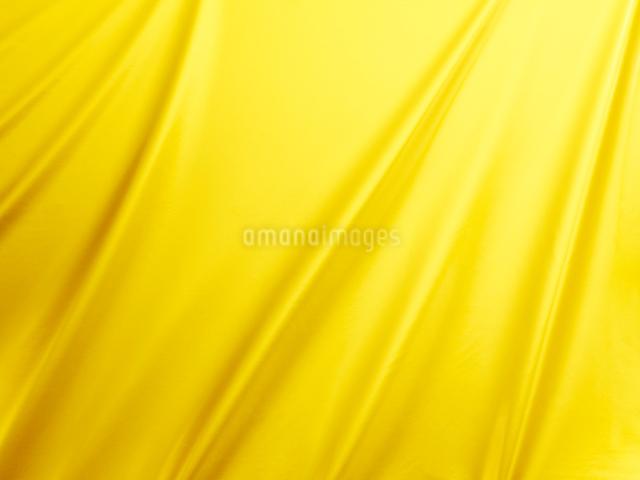 金の布のドレープの背景素材の写真素材 [FYI01382462]