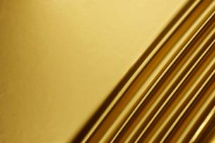 金のドレープの背景素材の写真素材 [FYI01390702]