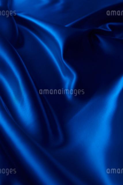 シルクの青い布のドレープの写真素材 [FYI01405770]