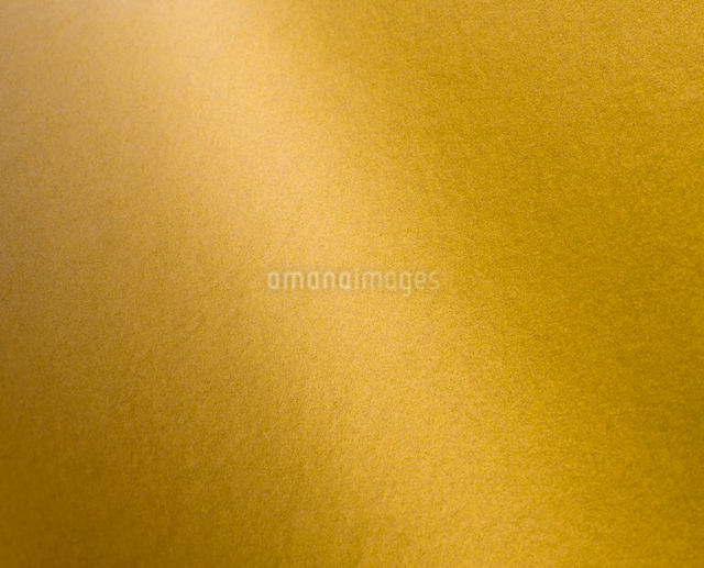金色のバックグランドの写真素材 [FYI01406906]