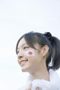 国旗のフェースペインティングした女子生徒の写真素材 [FYI01414764]