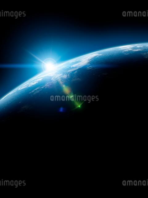 地球と日の出の写真素材 [FYI01415814]