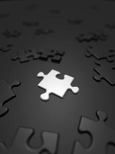 散らばる白と黒のジグソーパズルのイラスト素材 [FYI01416553]