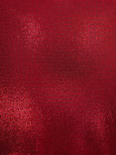 赤く光る布地の写真素材 [FYI01502580]