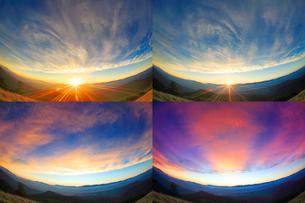 北アルプスの山並みと夕日と夕焼けの写真素材 [FYI01510030]